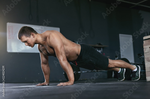 Fotografia, Obraz  Workout. Sports Man Doing Push Ups From Floor At Sport Club