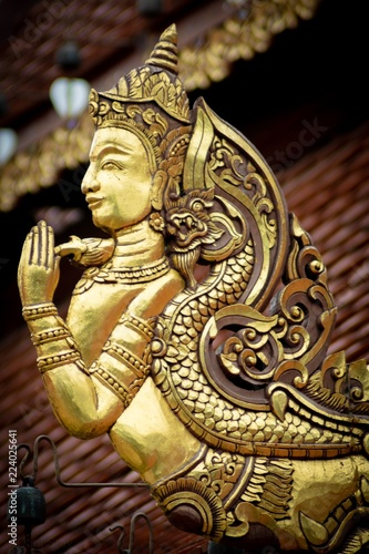 Staande foto Stained golden Buddhas, dragon, carving, wood,