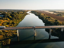 Aerial View Of Bridge Over Don River In Voronezh, Autumn Landscape From Above View With Highway Road And Car Transportation