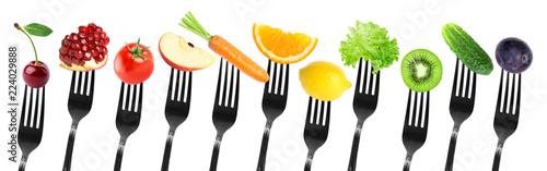 Color fruits and vegetables on fork