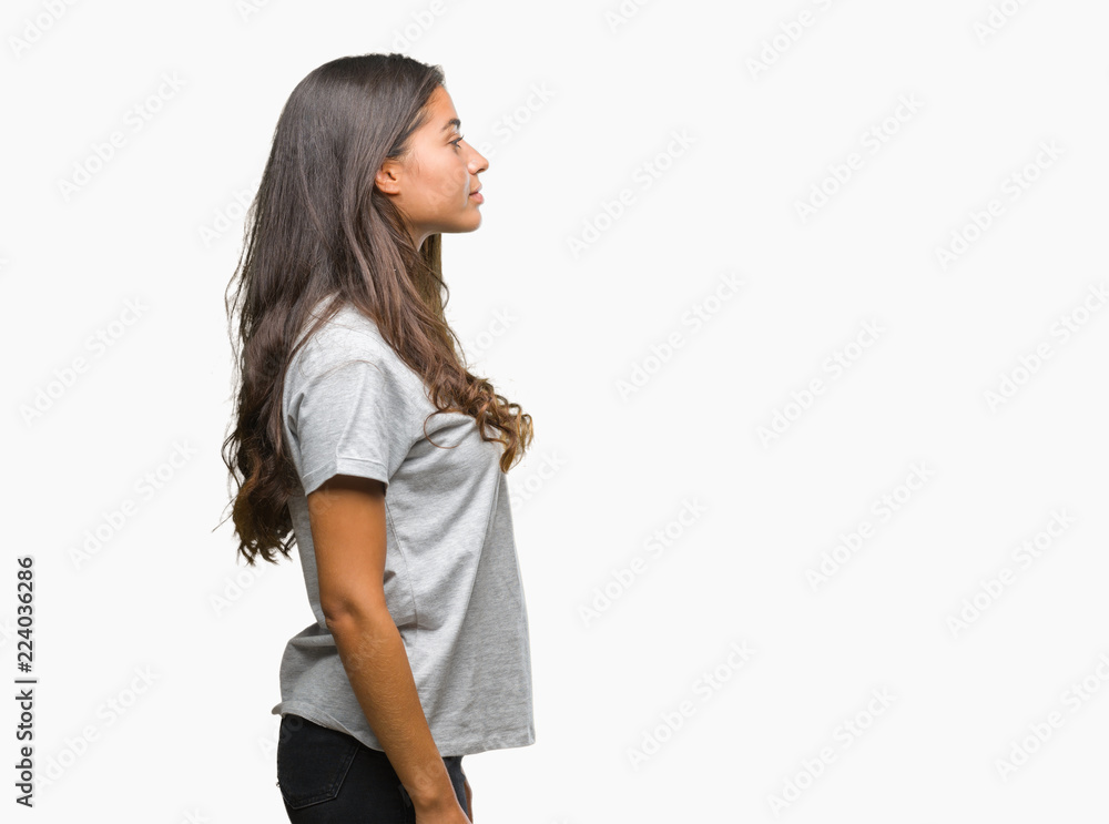 Fototapeta Young beautiful arab woman over isolated background looking to side, relax profile pose with natural face with confident smile.