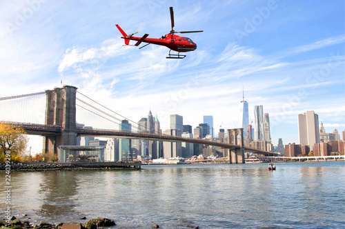 Deurstickers New York City Helicopter flying over New York City skyscrapers and Brooklyn Bridge, USA