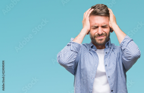 Fotomural Young handsome man wearing white t-shirt over isolated background suffering from headache desperate and stressed because pain and migraine