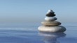 A pyramid of stones above the water. Massage parlor. Spa business.