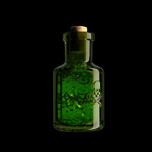 A Glass Vial With A Skull And ...