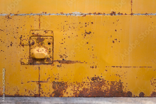 Acrylic Prints Old abandoned buildings rusted yellow bus board with small hatch