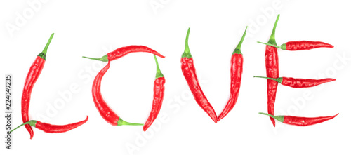 Word love written from red hot pepper letters isolated on white background