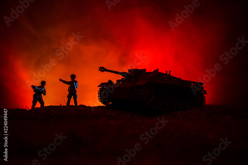 Keuken foto achterwand Nasa War Concept. Military silhouettes fighting scene on war fog sky background, World War German Tanks Silhouettes Below Cloudy Skyline At night. Attack scene. Armored vehicles.