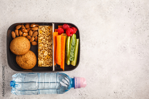 Foto op Aluminium Assortiment Healthy meal prep containers with cereal bar, fruits, vegetables and snacks. Takeaway food on white background, top view.