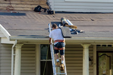 Roofers Are Changing Roof Shin...