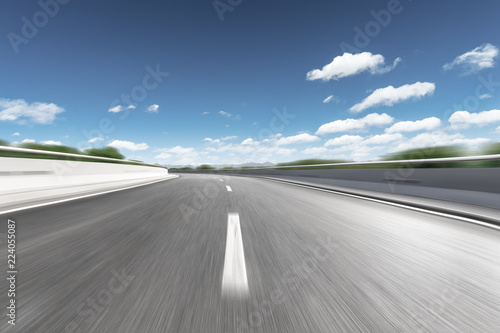 blurred motion highway through country side