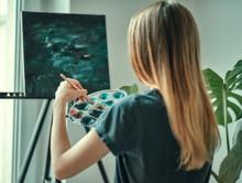 Painter Draws A Picture