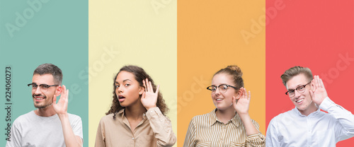 Obraz na plátně Collage of a group of people isolated over colorful background smiling with hand over ear listening an hearing to rumor or gossip
