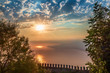 Fortress wall on mountain view of sunset on sea