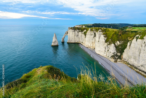 cliffs Aval and Needle of Etretat and beautiful famous coastline during the tide Wallpaper Mural
