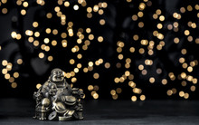 Laughing Buddha Golden Statue Bokeh Lights Background