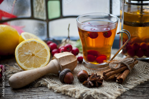 Hawthorn and ripe hawthorn fruit, tea with hawthorn and lemon