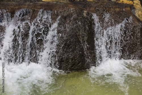 foreground of a small waterfall