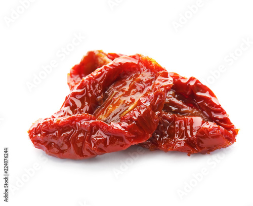 Fototapeta Tasty sun dried tomatoes on white background obraz