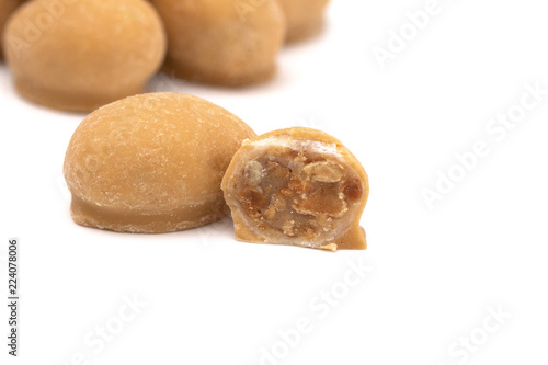Fotografie, Obraz  Toffee and Peanut Candies Covered in Maple