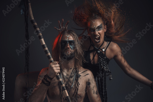 Fotografie, Obraz  Dark shaman or tribal warlock summoning a succubus demon, screaming witch or oth