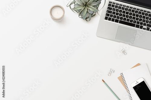 Fotografie, Obraz  stylish modern minimalist workspace with laptop computer, white smartphone, offi