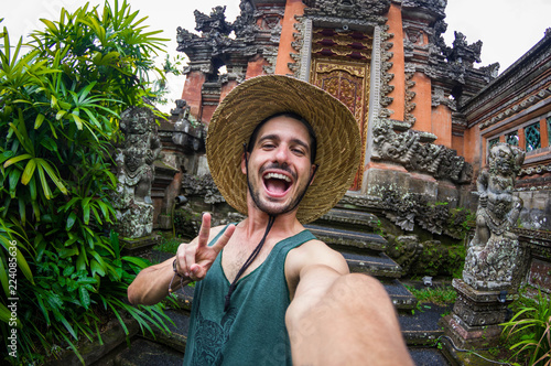 Handsome man taking a selfie on a trip in Asia Canvas-taulu