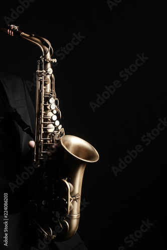 Foto auf Leinwand Musik Saxophone player. Saxophonist with jazz musical instrument