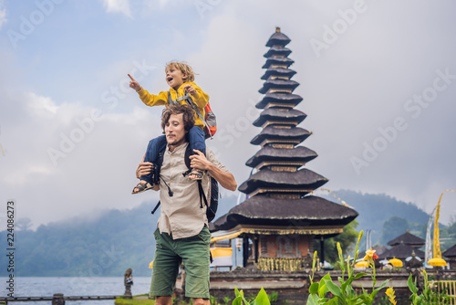 Deurstickers Bedehuis Dad and son in the background of Pura Ulun Danu Bratan, Bali. Hindu temple surrounded by flowers on Bratan lake, Bali. Major Shivaite water temple in Bali, Indonesia.Traveling with children concept