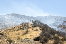 Firefighters Battle A Blaze Along The Mountains Near El Cajon Pass In Southern California