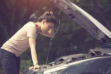 Women Spection She Opened The Hood Broken Car On The Side See Engines That Are Damaged Or Not.Vintage Color