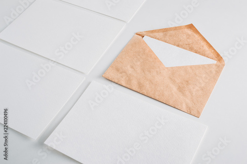 White Paper Empty Sheets Cards And Kraft Envelope On A White
