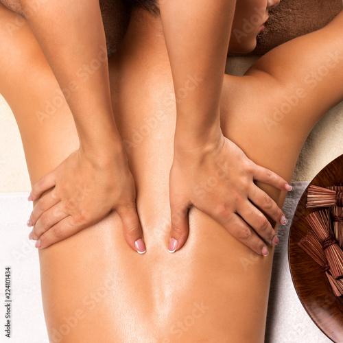 Цoman's body with back massage in spa salon.