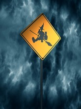 Warning Yellow Road Sign With Sitting Witch Icon. Storm Clouds On Backdrop. 3D Rendering