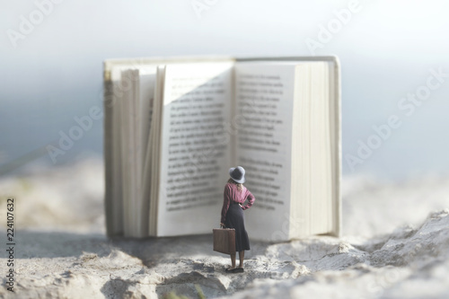 surreal journey of a woman inside the story of an adventurous book Fototapet