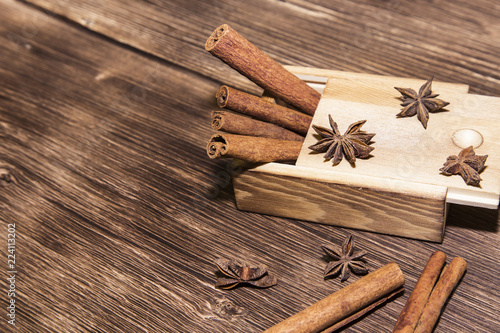 Food Asian Spices Cinnamon Sticks And Cardamom On The
