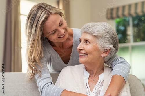 Canvas Print Woman embracing senior mother