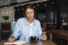 Mature Woman Relaxing At Cafe