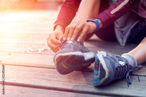 Runner tying her sport shoes