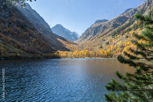 Poster Bergen Mountain Lake. Bright yellow and red autumn in the mountains. Kavkaz. Dombay.