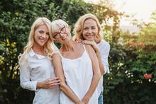Three Women Enjoying Outdoors,...