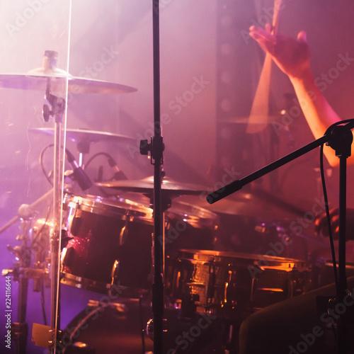 Hand with drumsticks near rock drum set - 224116644
