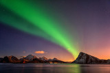 Northern lights, Aurora borealis in Lofoten islands, Norway. Night winter landscape with polar lights and beautiful starry sky