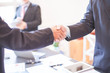 The agreement between business groups businessman shaking hands concept .
