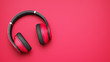 canvas print picture - pink and black wireless headphones isolated on pink background