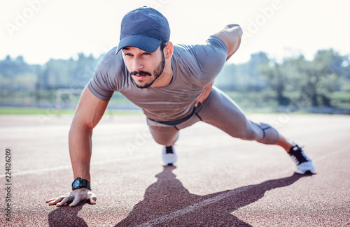 Young sportsman during his training outdoors Wallpaper Mural