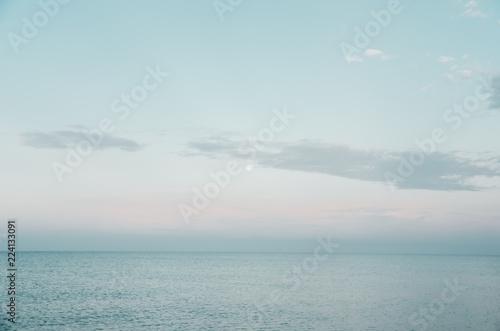 Papiers peints Blanc Sunset by the sea. Blue sky, blue water