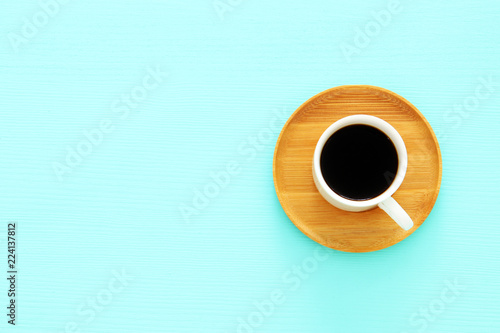 Fototapeta Top view image of coffe cup over wooden mint blue background. Flat lay. Copy space. obraz