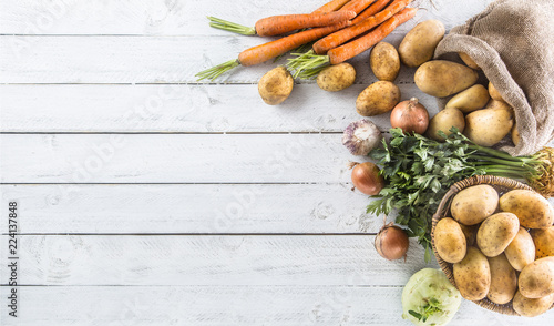 Canvas Prints Vegetables Potatoes onion carrot celery kohlrabi and garlic.