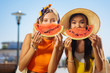 canvas print picture - Extremely delicious. Joyful happy women smiling to you while enjoying their tasty watermelon